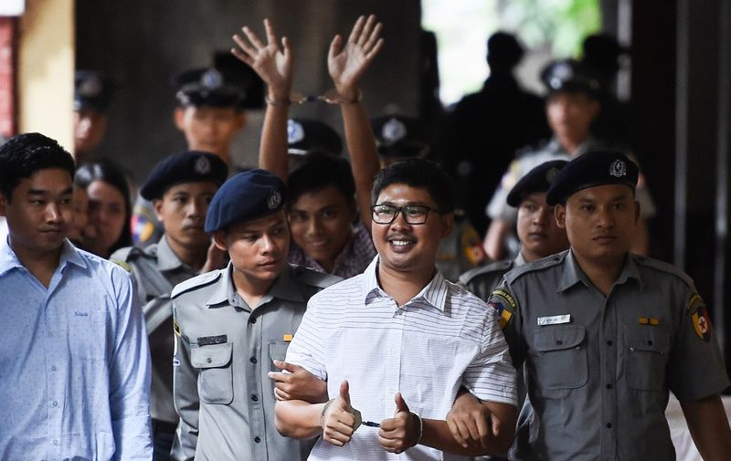 (FILES) In this file photo taken on August 27, 2018, Reuters journalists Wa Lone (front) and Kyaw Soe Oo (C-back) arrive in court in Yangon to face their verdict on charges linked to their reporting of the Rohingya crisis. - Myanmar's Supreme Court on April 23, 2019 rejected an appeal by the two Reuters journalists jailed for seven years on charges linked to their reporting on the Rohingya crisis, a defence lawyer confirmed. (Photo by Ye Aung THU / AFP)