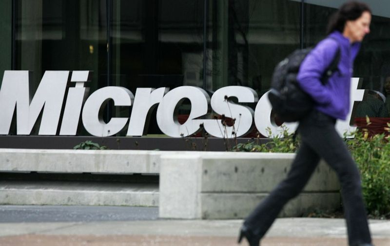 REDMOND, WA - JANUARY 22: A person walks past a Microsoft sign on January 22, 2009 in Redmond, Washington. The company annouced earlier today they would be laying off up to 5000 employees within the next 18 months.   Robert Giroux/Getty Images/AFP