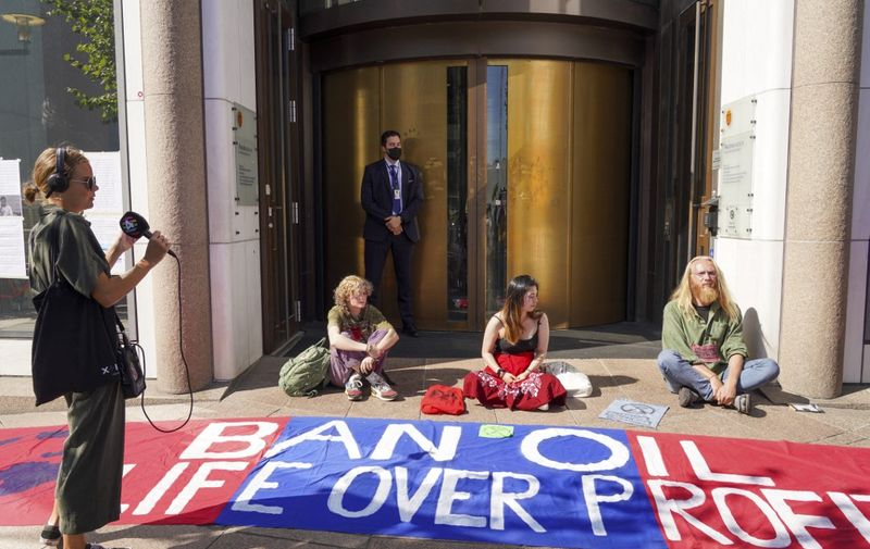 Extinction Rebellion environmental activists stage a protest outside the premises of the Ministry of Petroleum and Energy in Oslo, on August 23, 2021. - The environmental activists announced a number of actions in Oslo this week. (Photo by Ole Berg-Rusten / NTB / AFP) / Norway OUT