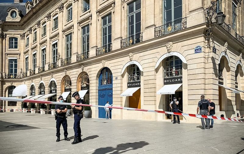"""On September 7, 2021, around noon, several armed individuals robbed a jewelry store of the brand """"Bulgari"""" located in Place Vendôme in the center of Paris before fleeing during which a police officer was knocked down and a robber was shot. The police are on guard at the scene while the judicial police investigate inside the store. Paris: Jewelry Shop Robbery At Place Vendome, France - 07 Sep 2021,Image: 630857580, License: Rights-managed, Restrictions: , Model Release: no, Credit line: Profimedia"""
