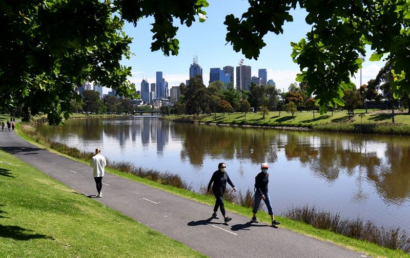 People enjoy the spring weather along the banks of Melbourne's Yarra River on October 16, 2020, as Australia's Victoria state records only two new COVID-19 coronavirus cases and no deaths, the lowest daily figure since June 9. (Photo by William WEST / AFP)