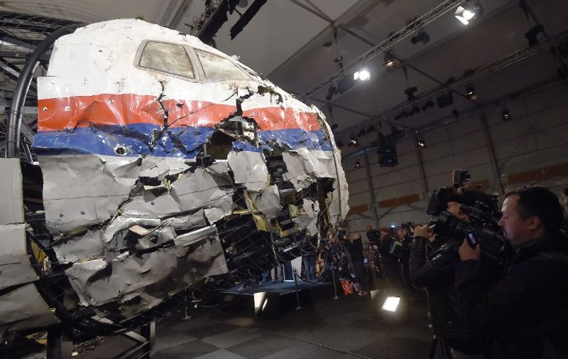 The wrecked cockipt of the Malaysia Airlines flight  MH17 is presented to the press during a presentation of the final report on the cause of the its crash at the Gilze Rijen airbase October 13, 2015. Air crash investigators have concluded that Malaysia Airlines flight MH17 was shot down by a missile fired from rebel-held eastern Ukraine, sources close to the inquiry said today, triggering a swift Russian denial. The findings are likely to exacerbate the tensions between Russia and the West, as ties have strained over the Ukraine conflict and Moscow's entry into the Syrian war.   AFP PHOTO / EMMANUEL DUNAND