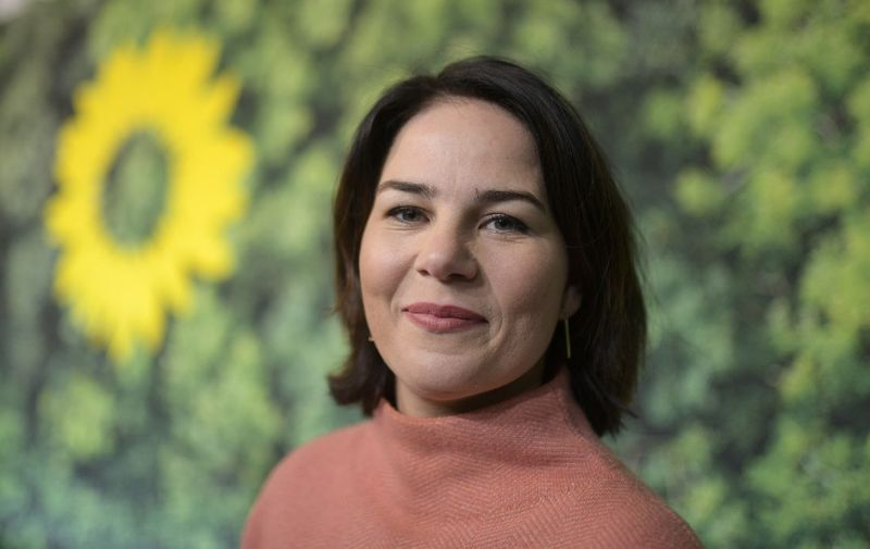 (FILES) This file photo taken on November 14, 2019 shows German Green party co-leader Annalena Baerbock as she tours the venue prior to a two-day party congress in Bielefeld, western Germany. - Germany's Green party on Monday, April 19, 2021 named its co-chair Annalena Baerbock as their candidate to succeed Angela Merkel, throwing down the gauntlet to the chancellor's conservatives who were locked in increasingly vicious infighting for her crown. (Photo by Ina FASSBENDER / AFP)