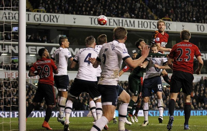 West Bromwich Albion's English defender Craig Dawson (Top R) scores his team's first goal during the English Premier League football match between Tottenham Hotspur and West Bromwich Albion at White Hart Lane in London, on April 25, 2016. / AFP PHOTO / IKIMAGES / IKimages / RESTRICTED TO EDITORIAL USE. No use with unauthorized audio, video, data, fixture lists, club/league logos or 'live' services. Online in-match use limited to 45 images, no video emulation. No use in betting, games or single club/league/player publications.