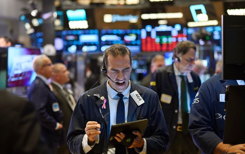 Traders work after the opening bell at the New York Stock Exchange (NYSE) on August 15, 2019 at Wall Street in New York City. Wall Street stocks opened higher Thursday following mixed US economic data, bouncing modestly after the Dow suffered its worst session of the year. About five minutes into trading, the Dow Jones Industrial Average was at 25,531.36, up 0.2 percent. The broad-based S&P 500 also added 0.2 percent at 2,846.22, along with the tech-rich Nasdaq Composite Index, which stood at 2,846.22., Image: 465544356, License: Rights-managed, Restrictions: , Model Release: no, Credit line: Profimedia, AFP