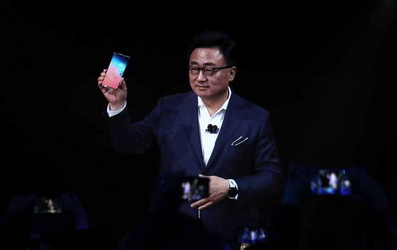 SAN FRANCISCO, CALIFORNIA - FEBRUARY 20: DJ Koh, President and CEO of IT & Mobile Communications Division of Samsung Electronics, holds the new Samsung Galaxy S10 smartphone during the Samsung Unpacked event on February 20, 2019 in San Francisco, California. Samsung announced a new foldable smartphone.   Justin Sullivan/Getty Images/AFP