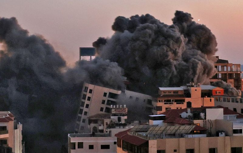 Smoke billows from an Israeli air strike on the Hanadi compound in Gaza City, controlled by the Palestinian Hamas movement, on May 11, 2021. (Photo by MOHAMMED ABED / AFP)