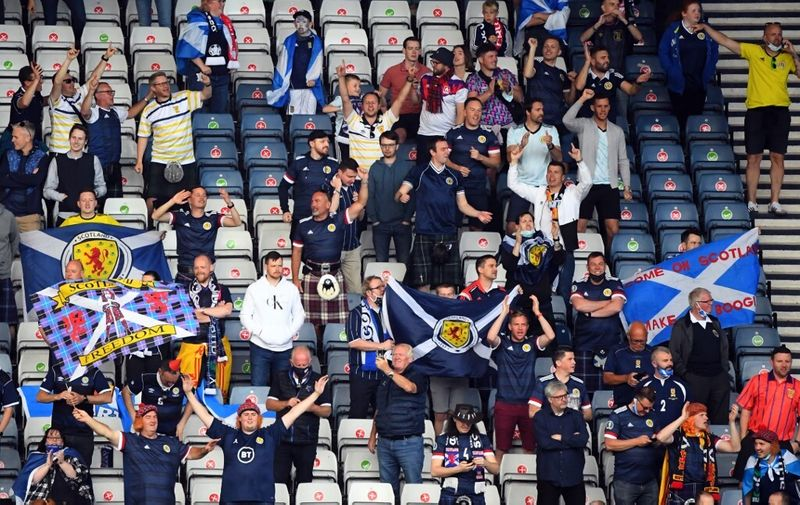 Scotland supporters cheer ahead of the UEFA EURO 2020 Group D football match between Croatia and Scotland at Hampden Park in Glasgow on June 22, 2021. (Photo by ANDY BUCHANAN / POOL / AFP)