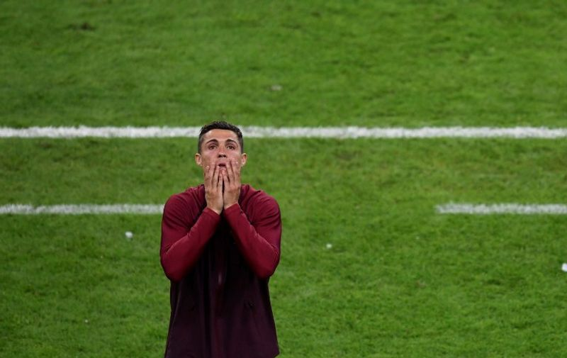 Portugal's forward Cristiano Ronaldo reacts during the Euro 2016 final football match between Portugal and France at the Stade de France in Saint-Denis, north of Paris, on July 10, 2016. / AFP PHOTO / MIGUEL MEDINA