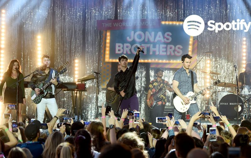 NEW YORK, NEW YORK - JUNE 06: Nick Jonas, Joe Jonas and Kevin Jonas perform onstage as Spotify Hosts A Carnival Of Happiness For The Jonas Brothers And Their Top Listeners To Celebrate The Launch Of Their New Album Happiness Begins on June 06, 2019 in New York City. (Photo by Dimitrios Kambouris/Getty Images for Spotify)