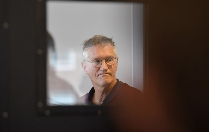State epidemiologist Anders Tegnell of the Public Health Agency of Sweden is seen through a door glass prior to a daily news conference on the new coronavirus COVID-19 situation, in Stockholm, Sweden, on April 28, 2020. (Photo by Jessica GOW / TT NEWS AGENCY / AFP) / Sweden OUT