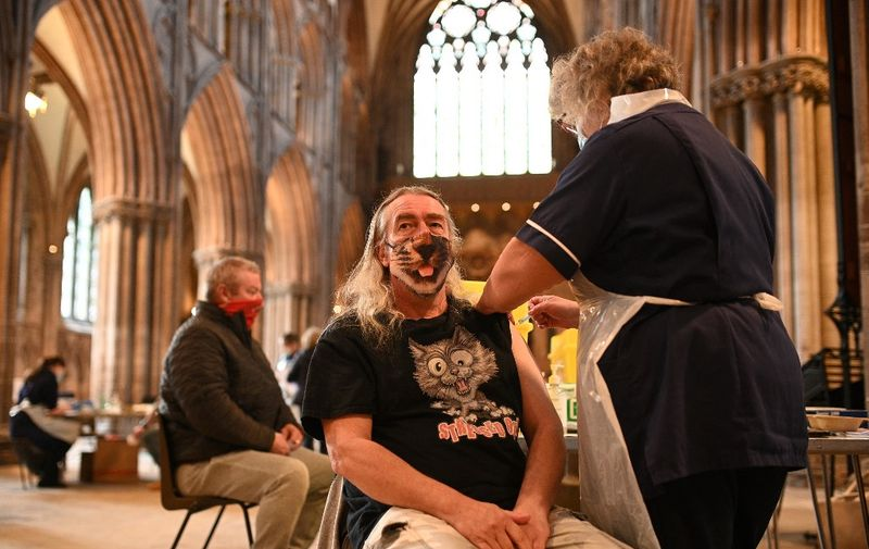Members of the public receive a dose of the AstraZeneca/Oxford Covid-19 vaccine at Lichfield cathedral, which has been converted into a temporary vaccination centre, in Lichfield, central England on March 18, 2021. (Photo by Oli SCARFF / AFP)
