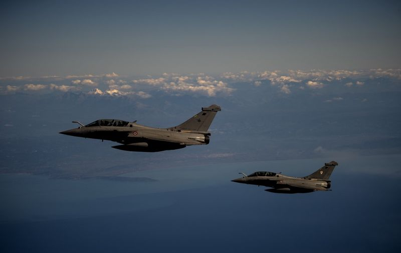 """Two French Air Force Rafale fighter jets fly over Greece during a joint military drill with Greece Air Force as part of French Air Force's mission """"Skyros 2021"""" on February 3, 2021. (Photo by ANGELOS TZORTZINIS / AFP)"""