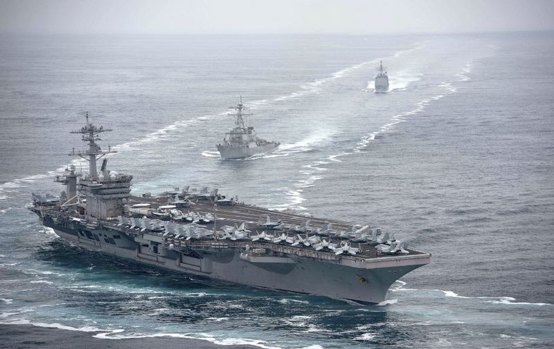 """This US Navy photo obtained August 4, 2019 shows the aircraft carrier USS Theodore Roosevelt (CVN 71), front, the Arleigh Burke-class guided-missile destroyer USS Russell (DDG 59), center, and the Ticonderoga-class guided-missile cruiser USS Bunker Hill (CG 52) transit in formation on July 31, 2019 in the Pacific Ocean. - Theodore Roosevelt, Russell and Bunker Hill are conducting routine operations in the eastern Pacific Ocean. (Photo by Anthony J. RIVERA / Navy Office of Information / AFP) / RESTRICTED TO EDITORIAL USE - MANDATORY CREDIT """"AFP PHOTO / US NAVY/ANTHONY J. RIVERA/HANDOUT"""" - NO MARKETING - NO ADVERTISING CAMPAIGNS - DISTRIBUTED AS A SERVICE TO CLIENTS"""