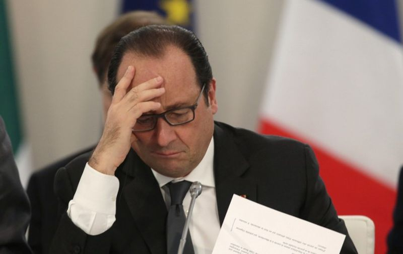 """French President Francois Hollande takes part in """"The Climate Challenge and African solutions"""" event as part of the World Climate Change Conference 2015 (COP21), at Le Bourget on the outskirts of the French capital Paris. World leaders opened an historic summit in the French capital with """"the hope of all of humanity"""" laid on their shoulders as they sought a deal to tame calamitous climate change.  / AFP / POOL / PHILIPPE WOJAZER"""