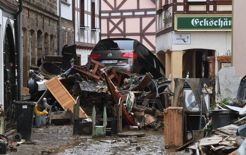 Debris and a damaged car pile up in a street in Bad Neuenahr-Ahrweiler, western Germany, on July 16, 2021, after heavy rain hit parts of the country, causing widespread flooding and major damage. - The death toll from devastating floods in Europe soared to at least 126 on July 16, most in western Germany where emergency responders were frantically searching for missing people. (Photo by Christof STACHE / AFP)