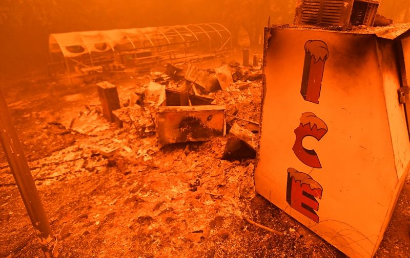 A singed ice machine sits over a burned store during the Bear fire, part of the North Lightning Complex fires, in unincorporated Butte County, California on September 09, 2020. - Dangerous dry winds whipped up California's record-breaking wildfires and ignited new blazes Tuesday, as hundreds were evacuated by helicopter and tens of thousands were plunged into darkness by power outages across the western United States. (Photo by JOSH EDELSON / AFP)