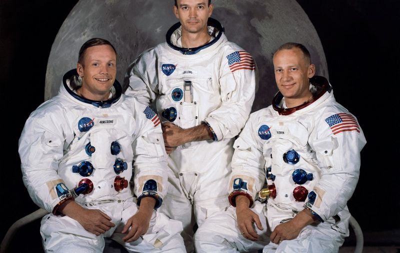 """(FILES) In this file photo obtained from NASA, shows the official crew portrait of the Apollo 11 astronauts taken at the Kennedy Space center on March 30, 1969, (shown L-R) are Neil A. Armstrong, Commander; Michael Collins, Module Pilot; Edwin E. """"Buzz"""" Aldrin, Lunar Module Pilot. - American astronaut Michael Collins, who flew the Apollo 11 command module while his crewmates became the first people to land on the Moon in 1969, died on April 28, 2021 after battling cancer, his family said. """"Mike always faced the challenges of life with grace and humility, and faced this, his final challenge, in the same way,"""" Collins' family tweeted on his official Twitter account. (Photo by HO / NASA / AFP) / **RESTRICTED TO EDITORIAL USE - MANDATORY CREDIT """"AFP PHOTO / NASA"""" - NO MARKETING - NO ADVERTISING CAMPAIGNS - DISTRIBUTED AS A SERVICE TO CLIENTS **TO GO WITH AFP STORY by Ivan Couronne, """"To the Moon and back: mankind's giant leap 50 years on"""""""