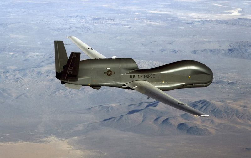 """This undated US Air Force file photo released on June 20, 2019 shows a photo of a RQ-4 Global Hawk unmanned surveillance and reconnaissance aircraft. - A US spy drone was some 34 kilometers (21 miles) from the nearest point in Iran when it was shot down over the Strait of Hormuz by an Iranian surface-to-air missile June 20, 2019, a US general said. """"This dangerous and escalatory attack was irresponsible and occurred in the vicinity of established air corridors between Dubai, UAE, and Oman, possibly endangering innocent civilians,"""" said Lieutenant General Joseph Guastella, who commands US air forces in the region.""""At the time of the intercept the RQ-4 was at high altitude, approximately 34 kilometers from the nearest point of land on the Iranian coast,"""" he said, over a video to the Pentagon press briefing room. (Photo by Handout / US AIR FORCE / AFP) / RESTRICTED TO EDITORIAL USE - MANDATORY CREDIT """"AFP PHOTO / US AIR FORCE/HANDOUT"""" - NO MARKETING - NO ADVERTISING CAMPAIGNS - DISTRIBUTED AS A SERVICE TO CLIENTS"""