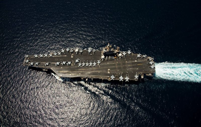 """Nimitz-class aircraft carrier USS Abraham Lincoln (CVN 72) transits through the Arabian Sea on April 5, 2012. The United States is keeping the pressure on Iran with the presence of two aircraft carriers close to the Gulf region ahead of the resumption of nuclear talks with Tehran this week. """"There are currently two carrier strike groups in the US 5th Fleet area of operations,"""" Lieutenant Commander John Fage, a navy spokesman, said April 9, 2012.Abraham Lincoln is deployed to the US 5th Fleet area of responsibility conducting maritime security operations, theater security cooperation efforts and support missions as part of Operation Enduring Freedom.      AFP PHOTO/HANDOUT/US NAVY/Mass Communication Specialist Seaman Apprentice Karolina A. Martinez (Photo by HO / US NAVY / AFP)"""