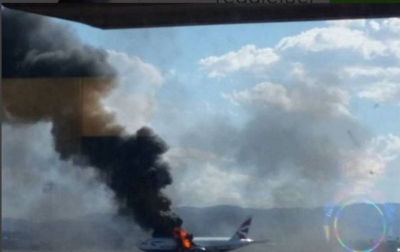 """This photograph posted on Instagram and taken September 8, 2015 shows a passenger plane on fire on the runway at McCarran International Airport in Las Vegas, Nevada.  A British Airways jet caught fire on the runway at McCarran International Airport in Las Vegas Tuesday, forcing the evacuation of the passengers on board. The Federal Aviation Administration said the fire broke out in the plane's left engine prompting the crew to abort takeoff.  AFP PHOTO/HANDOUT/ Reggie Bügmüncher == RESTRICTED TO EDITORIAL USE / MANDATORY CREDIT: """"AFP PHOTO / HANDOUT / REGGIE BÜGMÜNCHER""""/ NO MARKETING / NO ADVERTISING CAMPAIGNS / DISTRIBUTED AS A SERVICE TO CLIENTS =="""