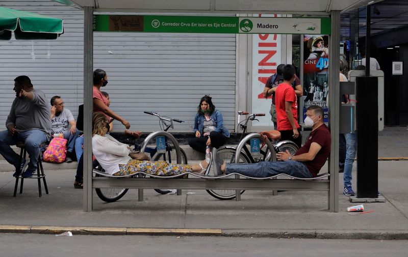 A couple lying down at a trolleybus stop on Eje Central in Mexico City during the COVID-19 health emergency and the orange epidemiological traffic light in the capital.  Currently, Mexico is the thirteenth most infected country in the world and has the third highest number of deaths due to the pandemic, behind the United States and Brazil, according to Johns Hopkins University in the United States. Coronavirus Emergency In Mexico, Mexico City - 24 Apr 2021,Image: 607764775, License: Rights-managed, Restrictions: , Model Release: no, Credit line: Profimedia