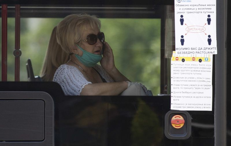 A woman with a mask and gloves on the bus during the new coronavirus lockdown. Coronavirus outbreak, Belgrade, Serbia - 08 Jul 2020,Image: 541445197, License: Rights-managed, Restrictions: , Model Release: no