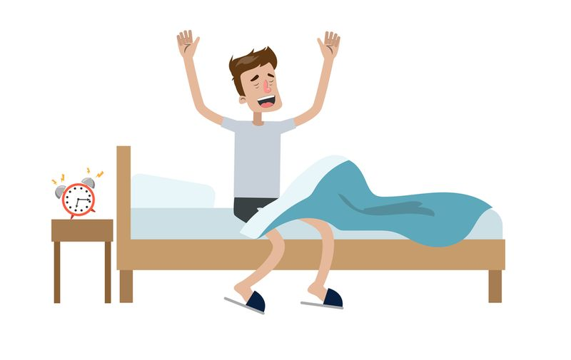 Man waking up in the bed and stretching.,Image: 394186856, License: Royalty-free, Restrictions: , Model Release: yes