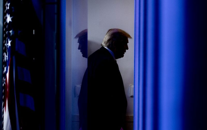 (FILES) In this file photo taken on April 17, 2020, US President Donald Trump departs after speaking during the daily briefing on the novel coronavirus, which causes COVID-19, in the Brady Briefing Room of the White House in Washington, DC. - Incumbent US President Donald Trump has been denied a second term after challenger, former US Vice President Joe Biden won the election, TV networks projected on November 7, 2020, a victory sealed after the Democrat claimed several key battleground states won by the Republican incumbent in 2016. CNN, NBC News and CBS News called the race in his favor, after projecting he had won the decisive state of Pennsylvania. His running mate, US Senator Kamala Harris, has become the first woman US Vice President elected to the office. (Photo by JIM WATSON / AFP)