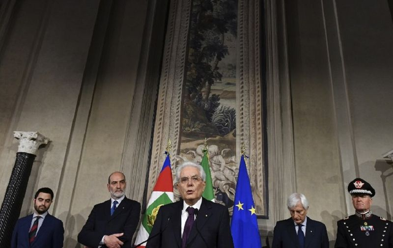 """Italy's President Sergio Mattarella (C) addresses journalists after a meeting with Italy's prime ministerial candidate Giuseppe Conte on May 27, 2018 at the Quirinale presidential palace in Rome. Italy's prime ministerial candidate Giuseppe Conte gave up his mandate to form a government after talks with the president over his cabinet collapsed. """"I have given up my mandate to form the government of change. I thank the president of the republic for having given me the mandate on May 23. I thank the two political forces Luigi Di Miao for the Five Star and Matteo Salvini from the League for having put me up as a candidate,"""" said Conte to reporters after leaving a failed summit with president Sergio Mattarella today. / AFP PHOTO / Vincenzo PINTO"""