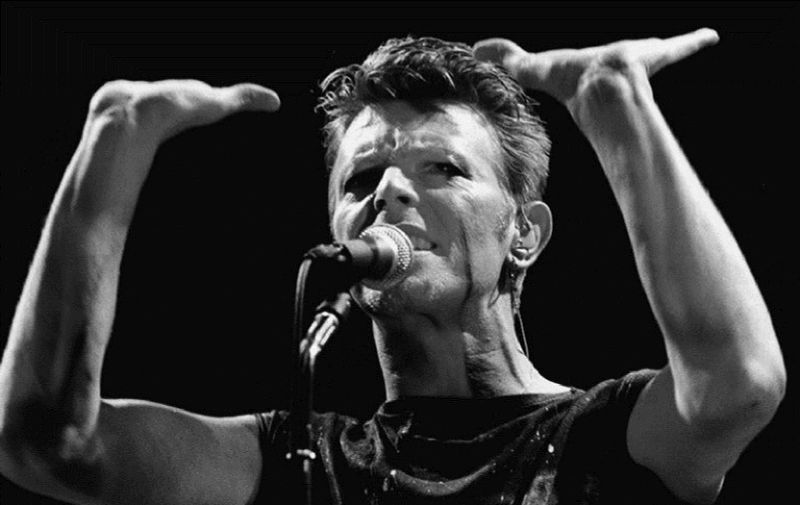 """(FILES) A photo taken in May 1983 shows British rock music legend David Bowie performing on stage during a concert at the Festhalle in Frankfurt am Main, western Germany.   Bowie has died after a long battle with cancer, his official Twitter and Facebook accounts said on January 11, 2016. The iconic musician had turned 69 only on January 8, which coincided with the release of """"Blackstar"""", his 25th studio album. / AFP / DPA / Katja Lenz / Germany OUT"""