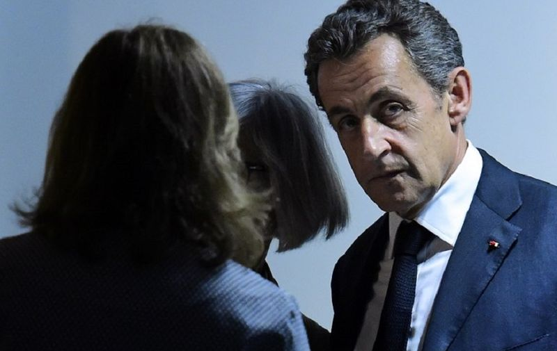 """French former president Nicolas Sarkozy (R) looks on after giving a press conference with Spanish Prime Minister, at the Spanish ruling Popular Party (PP) headquarters in Madrid, on June 29, 2015. Former French president Nicolas Sarkozy today urged the European Union not to """"yield"""" to Greece following the break up of talks between Athens and its international bailout creditors. AFP PHOTO / GERARD JULIEN"""