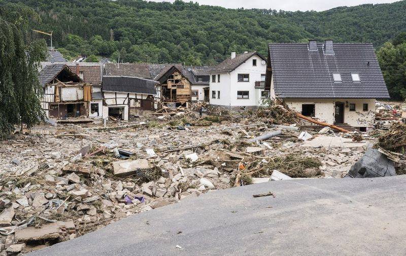 Partial view of debris and damaged houses destroyed by the floods in Schuld near Bad Neuenahr, western Germany, on July 15, 2021. - Heavy rains and floods lashing western Europe have killed at least 20 people in Germany and left around 50 missing, as rising waters led several houses to collapse. (Photo by Bernd Lauter / AFP)