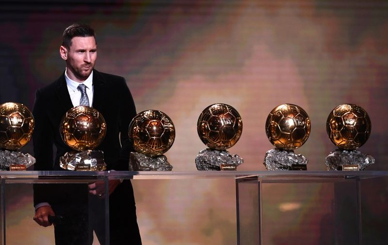 Barcelona's Argentinian forward Lionel Messi reacts after winning the Ballon d'Or France Football 2019 trophy at the Chatelet Theatre in Paris on December 2, 2019. - Lionel Messi won a record-breaking sixth Ballon d'Or on Monday after another sublime year for the Argentinian, whose familiar brilliance remained undimmed even through difficult times for club and country. (Photo by FRANCK FIFE / AFP)