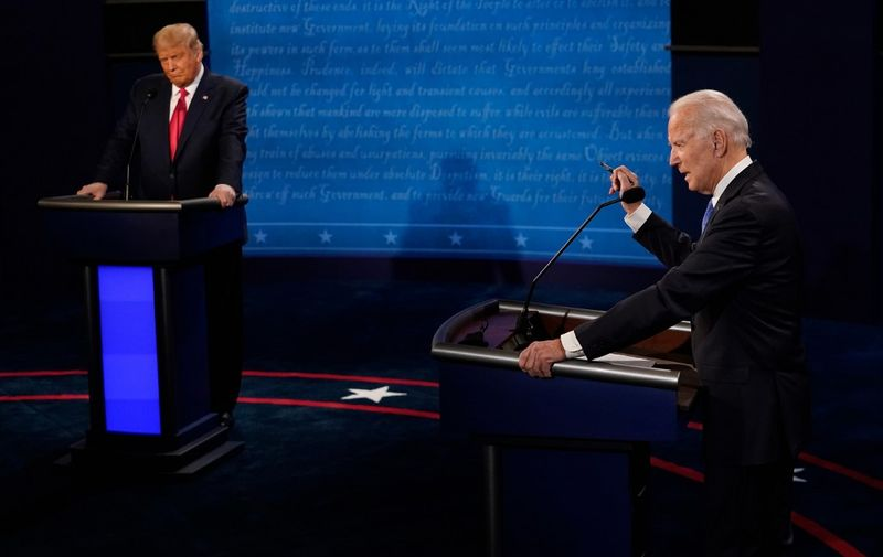 Democratic Presidential candidate and former US Vice President Joe Biden (R) and US President Donald Trump participate in the final presidential debate at Belmont University in Nashville, Tennessee, on October 22, 2020. (Photo by Morry GASH / POOL / AFP)
