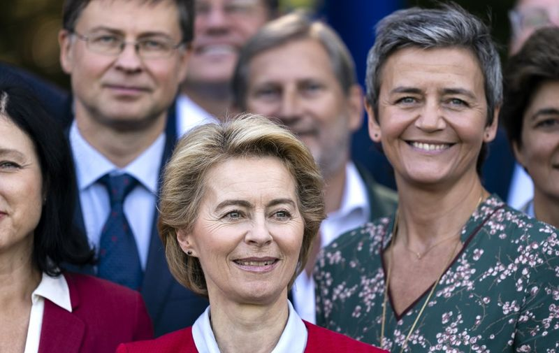 European Commission President Ursula von der Leyen looks on as she pose for a photo family during a seminar in Genval on September 12, 2019. (Photo by Kenzo TRIBOUILLARD / AFP)