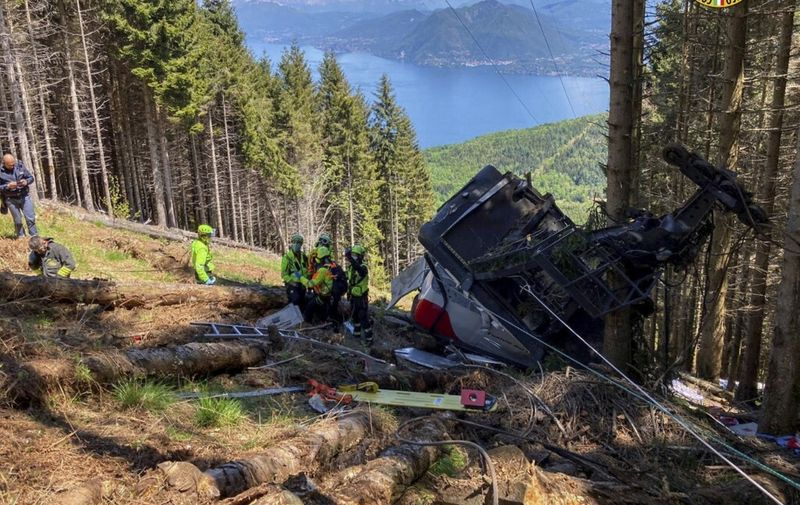 """A photo taken and handout on May 23, 2021 by The Italian National Alpine and Speleological Rescue Corps (Corpo Nazionale Soccorso Alpino e Speleologico) shows a cable car that crashed to the ground in the resort town of Stresa on the shores of Lake Maggiore in the Piedmont region. - Eight people died and another two were seriously injured Sunday after a cable car crashed to the ground in northern Italy, emergency services said. (Photo by Handout / Corpo Nazionale Soccorso Alpino e Speleologico / AFP) / RESTRICTED TO EDITORIAL USE - MANDATORY CREDIT """"AFP PHOTO / CORPO NAZIONALE SOCCORSO ALPINO E SPELEOLOGICO / HANDOUT """" - NO MARKETING - NO ADVERTISING CAMPAIGNS - DISTRIBUTED AS A SERVICE TO CLIENTS"""