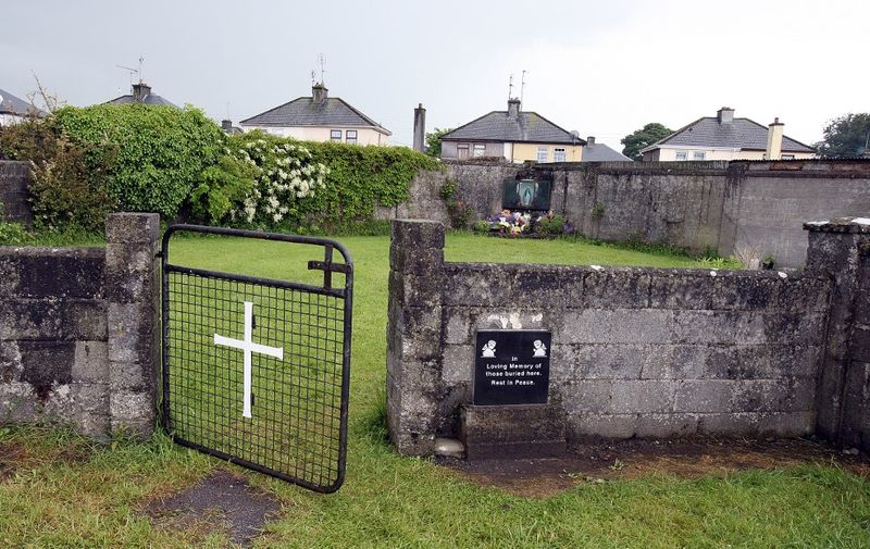 """(FILES) In this file photo taken on June 09, 2014 shows a shrine in Tuam, County Galway, erected in memory of up to 800 children who were allegedly buried at the site of the former home for unmarried mothers run by nuns. - Some 9,000 children died in Ireland's historic """"mother and baby homes"""" where unmarried mothers were separated from their infant offspring, an official report found on January 12, 2021. (Photo by PAUL FAITH / AFP)"""