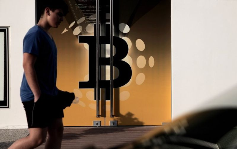 A man walks past the bitcoin firm Neo&Bee offices on April 3, 2014 in the Cypriot capital Nicosia. The boss of the Bitcoin company has fled abroad days after it suddenly stopped operations, in a blow to the virtual currency's once vaunted prospects on the Cypriot island. AFP PHOTO / YIANNIS KOURTOGLOU / AFP PHOTO / Yiannis Kourtoglou