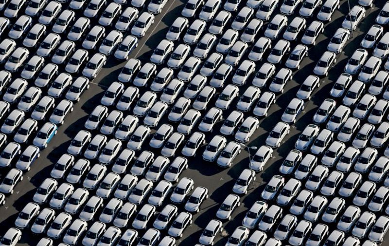 New Porsche cars are parked at the grounds of the Porsche plant in Leipzig, eastern Germany, on November 3, 2015. The US Environmental Protection Agency said late Monday, November 2, 2015, it had discovered that various six-cylinder 3.0 litre diesel VW Touareg, Porsche Cayenne and Audis were also rigged with a software which skews the results of pollution tests.     AFP PHOTO / DPA / JAN WOITAS   +++   GERMANY OUT   +++