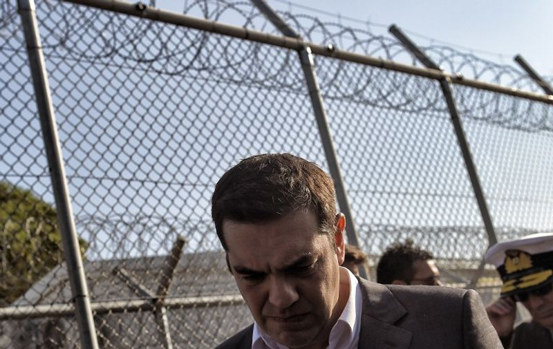 Greek Prime Minister Alexis Tsipras visits the Moria Hot Spot in Mytilene on November 5, 2015. Since the start of the summer, the Greek island of Lesbos has assumed notoriety as the main gateway into Europe for thousands of desperate refugees.  AFP PHOTO / ARIS MESSINIS