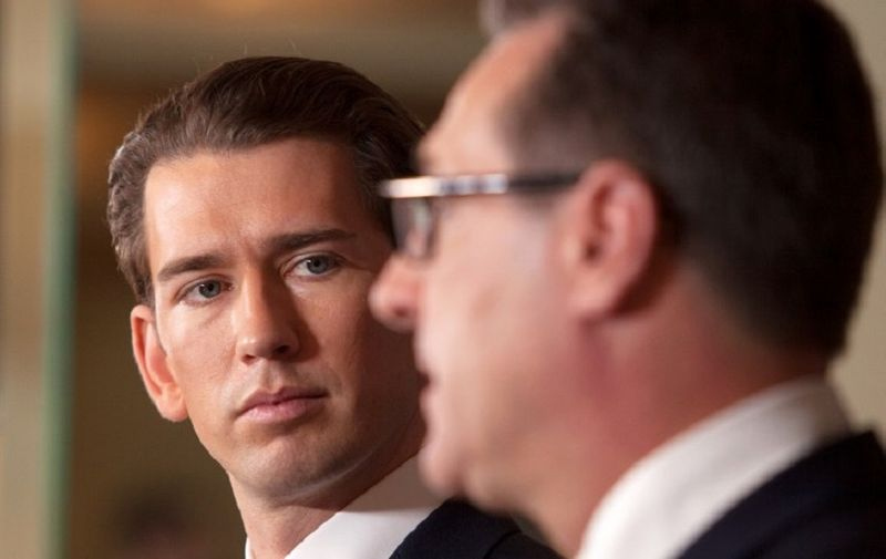 Future Austrian Chancellor Sebastian Kurz of the conservative People's Party (OeVP) listens during a joint press conference with incoming vice-chancellor of the far-right Freedom Party (FPOe) to unveil their joint programme on December 16, 2017 in Vienna, Austria. Austria's far-right has secured the interior, defence and foreign ministries in the new coalition government with the conservatives, Freedom Party (FPOe) head Heinz-Christian Strache said. Kurz's OeVPy will have the finance, economy and justice ministries, Kurz said. / AFP PHOTO / ALEX HALADA