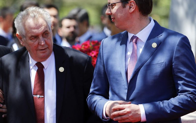 Serbia's Prime Minister Aleksandar Vucic (R) and Czech President Milos Zeman arrive for a family photo with other leaders during the Belt and Road Forum, at the International Conference Center in Yanqi Lake, north of Beijing, on May 15, 2017. - Chinese President Xi Jinping urged world leaders to reject protectionism on May 15 at a summit positioning Beijing as a champion of globalisation, as some countries raised concerns over his trade ambitions. (Photo by DAMIR SAGOLJ / POOL / AFP)