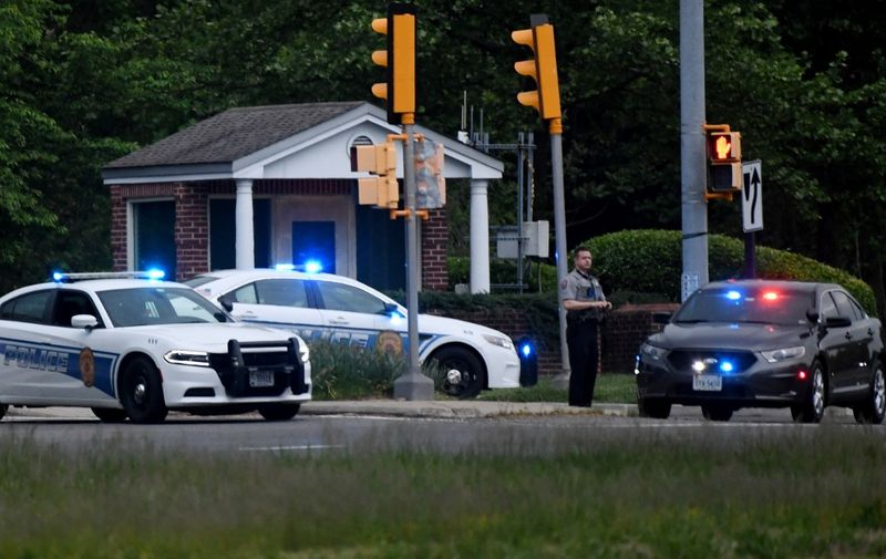 Police cars are seen outside the CIA headquarters's gate after an attempted intrusion earlier in the day in Langley, Virginia, on May 3, 2021. - An armed person was shot by FBI agents Monday after a standoff of several hours at the entry gate to the CIA headquarters, the federal investigation agency said. The unidentified person was prevented from driving past the initial gate into the CIA's sprawling wooded compound just outside Washington early Monday afternoon. (Photo by Olivier DOULIERY / AFP)