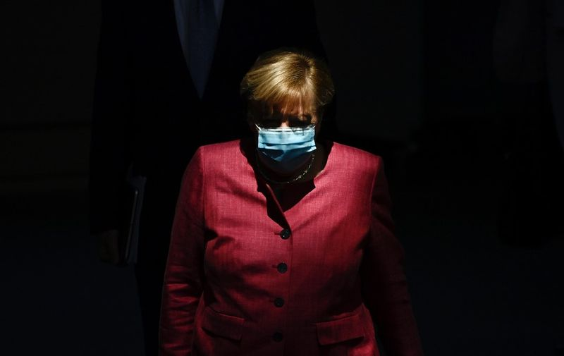 German Chancellor Angela Merkel wears a face mask as she arrives for a session of the German lower house of parliament Bundestag in Berlin on September 30, 2020. -  (Photo by Tobias SCHWARZ / AFP)