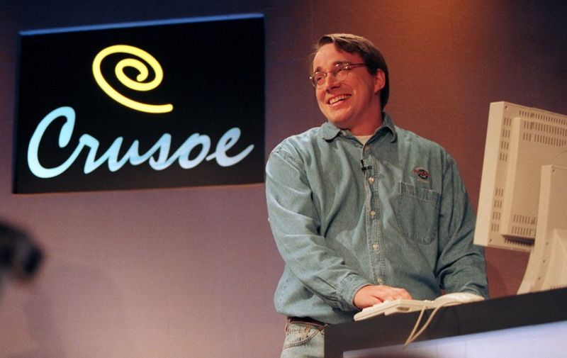 """Linus Torvalds, who wrote the free Linux computer operating software, demonstrates """"Crusoe"""" 19 January in Saratoga, California. Crusoe is a smart microprocessor based on sofware that could revolutionize the field of mobile computing.  Torvalds is part of Transmeta's engineering team for the Crusoe smart microprocessor. AFP PHOTO/John G. MABANGLO / AFP PHOTO / JOHN G. MABANGLO"""
