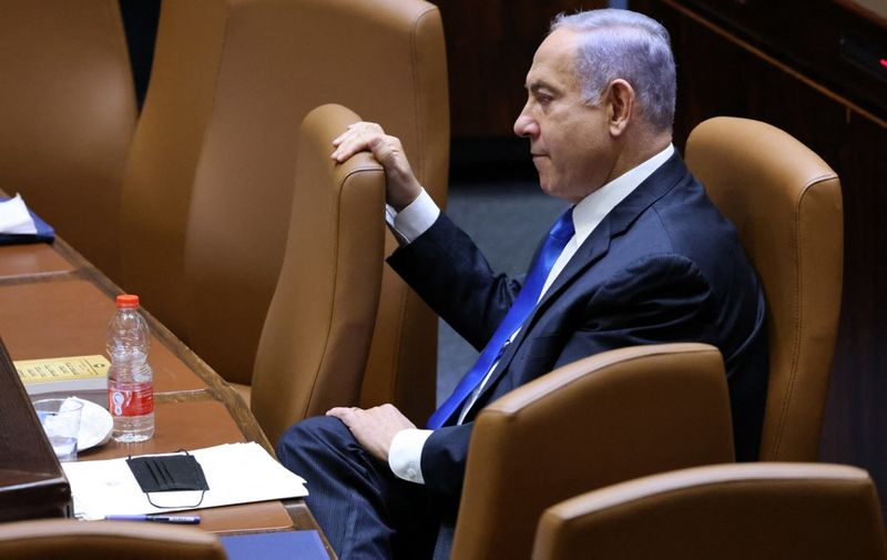 Israel's Prime Minister Benjamin Netanyahu attends a special session to vote on a new government at the Knesset in Jerusalem, on June 13, 2021. - A delicate eight-party alliance united by animosity for Netanyahu is poised to take over with right-wing Naftali Bennett as prime minister, if the coalition deal passes today's slated parliamentary vote. (Photo by EMMANUEL DUNAND / AFP)