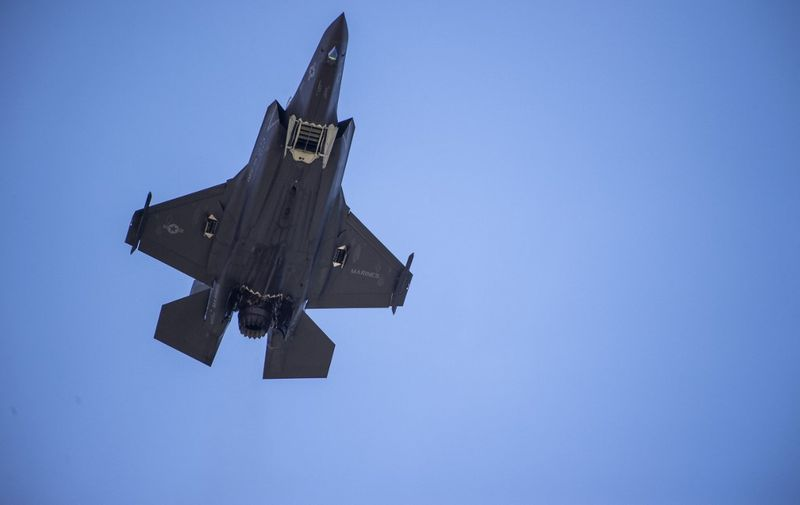 (FILES) In this file photo taken on June 12, 2019 an F-35 fighter plane flies over the White House, in Washington DC. - US President Joe Biden's administration has temporarily frozen for review a massive package of F-35 jets to the United Arab Emirates and arms to Saudi Arabia, officials said on January 27, 2021. (Photo by Eric BARADAT / AFP)