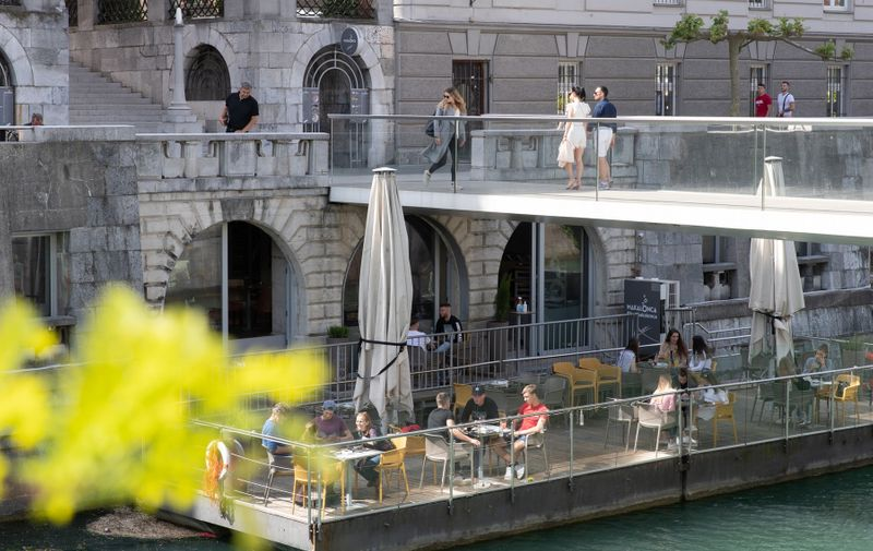 (200508) -- LJUBLJANA, May 8, 2020 () -- People enjoy their time at a cafe's terrace in Ljubljana, Slovenia, on May 8, 2020. Slovenia's COVID-19 death toll has risen to 100 after one more patient died on Thursday, according to the latest government data released on Friday.,Image: 518184787, License: Rights-managed, Restrictions: WORLD RIGHTS excluding China - Fee Payable Upon Reproduction - For queries contact Avalon.red - sales@avalon.red London: +44 (0) 20 7421 6000 Los Angeles: +1 (310) 822 0419 Berlin: +49 (0) 30 76 212 251, Model Release: no