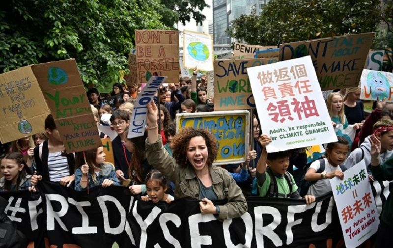 Students take part in a protest against climate change in Hong Kong on March 15, 2019, as part of a global movement called #FridaysForFuture. - Thousands of young people marched through cities in Asia on March 15, kicking off a global day of student protests that aims to spark world leaders into action on climate change. (Photo by Anthony WALLACE / AFP)